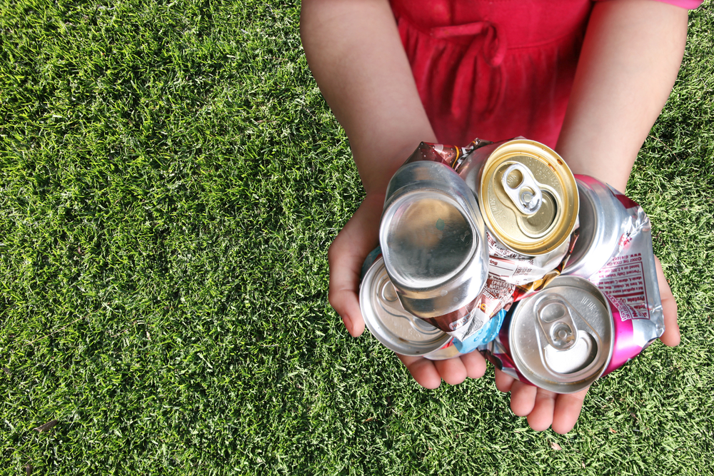 Aluminum Cans In Kids Hand